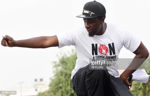 Senegalese rap singer and activist Simon speaks during a gathering against slavery on November 24 2017 on Place de l'Obelisque in Dakar World leaders...