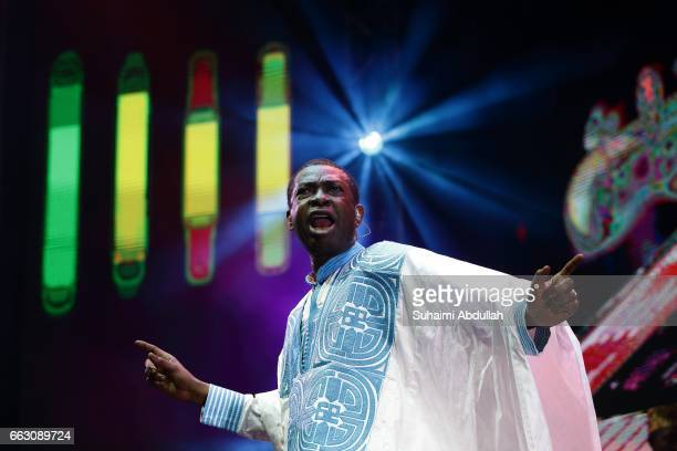 Senegalese singer and politician Youssou N'Dour performs on stage during the Singapore Jazz Festival 2017 at Marina Bay Sands Event Plaza on April 1...