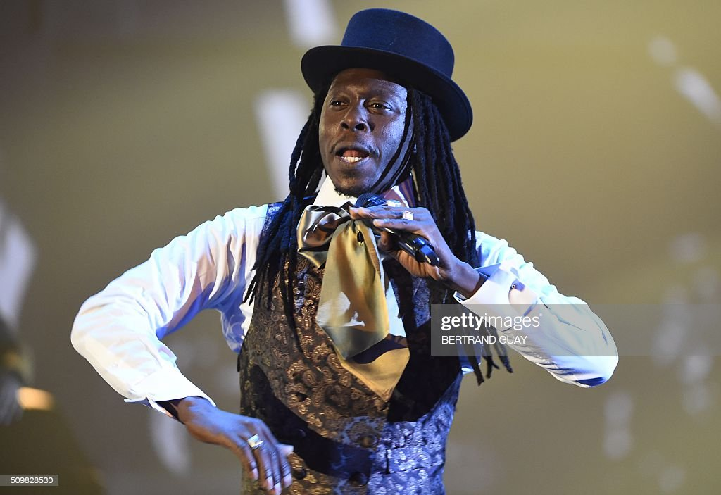 Senegalese singer and rapper Abdou Fatha Seck aka Faada Freddy performs during the 31st Victoires de la Musique, the annual French music awards ceremony, on February 12, 2016 at the Zenith concert hall in Paris. AFP PHOTO / BERTRAND GUAY / AFP / BERTRAND GUAY