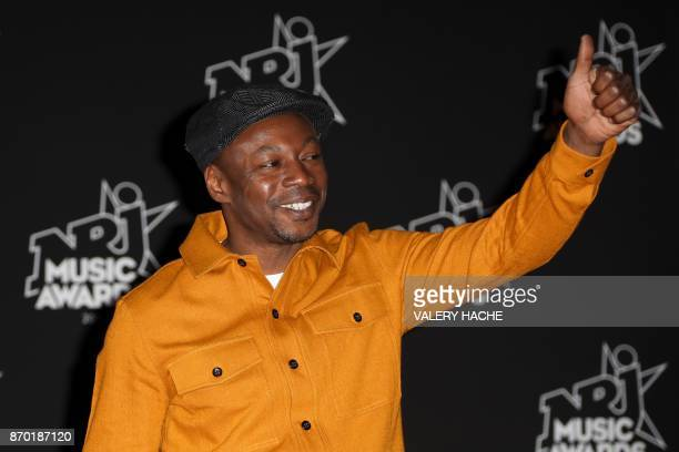 Senegalese singer Claude Honore M'Barali aka MC Solaar poses upon his arrival to attend the 19th NRJ Music Awards at the Palais des Festivals in...
