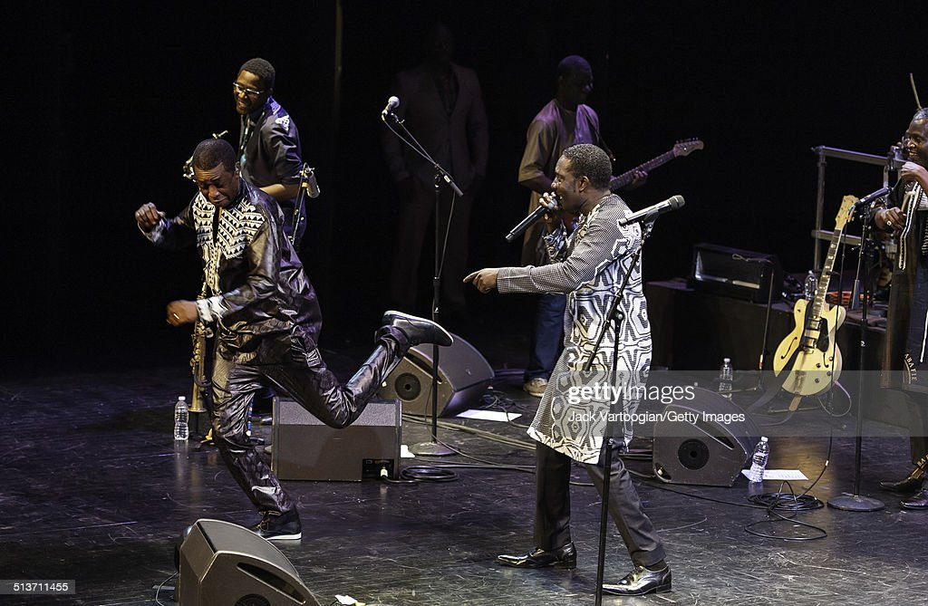 Senegalese singer (and politician) <a gi-track='captionPersonalityLinkClicked' href=/galleries/search?phrase=Youssou+N%27Dour&family=editorial&specificpeople=235392 ng-click='$event.stopPropagation()'>Youssou N'Dour</a> (left, fore) and Babacar Faye perform with N'Dour's band, Super Etoile de Dakar, during the 2014 Next Wave Festival at the BAM Howard Gilman Opera House, Brooklyn, New York, New York, September 12, 2014. The concert was part of a series celebrating the 50th anniversary of Nonesuch Records.