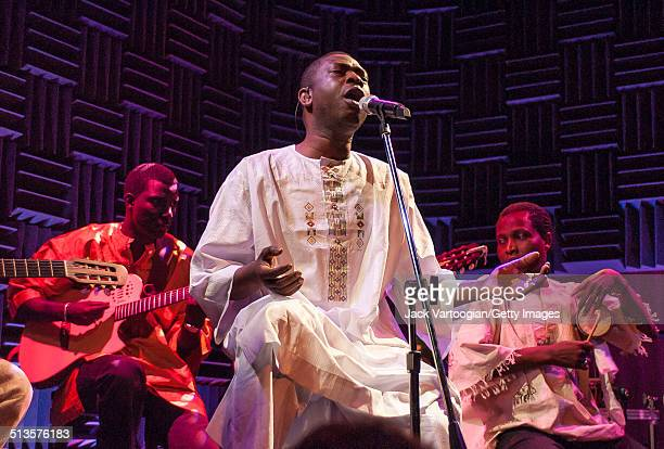 Senegalese singer Youssou N'Dour and members of his band Super Etoile de Dakar perform in an 'unplugged' acoustic set at Joe's Pub New York New York...