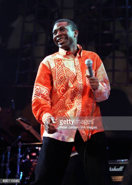 Senegalese singer Youssou N'dour performs at the Amnesty International Human Rights concert presented by The Body Shop at Bercy Stadium Paris The...