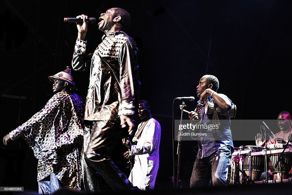Senegalese singer-songwriter and musician <a gi-track='captionPersonalityLinkClicked' href=/galleries/search?phrase=Youssou+N%27Dour&family=editorial&specificpeople=235392 ng-click='$event.stopPropagation()'>Youssou N'Dour</a> performing with his band at the WOMAD (World of Music, Arts and Dance) Festival at Charlton Park, Wiltshire, July 2014.