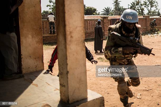 A Senegalese soldier from the MINUSCA the United Nations mission in Central African Republic runs for cover as heavy gunfire is directed towards the...