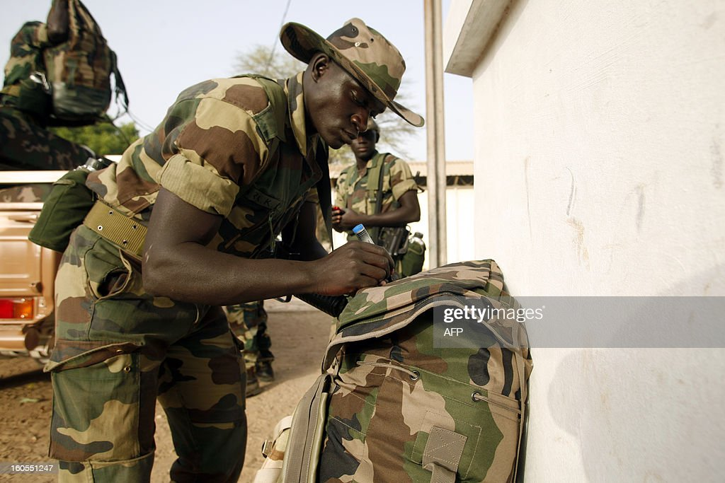 A Senegalese soldier prepares a bag, at the Captain Moussa Dioum military camp of Bargny, near Dakar, on February 2, 2013, before leaving for Mali as part of the second contingent of Senegalese troops to back Malian forces. French President Francois Hollande received a rapturous welcome in Mali on Saturday as he promised that France would stay as long as necessary to continue the fight against Islamist rebels in the country's north. As troops worked to secure Kidal, the last bastion of radicals who occupied the vast desert north for 10 months before the French army's surprise intervention, Hollande told Malians it was time for Africans to take the lead but that France would not abandon them. AFP PHOTO/Mamadou Toure BEHAN