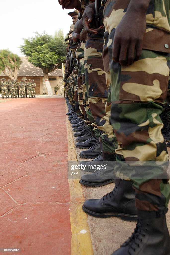 Senegalese soldiers prepare in the Captain Moussa Dioum military camp of Bargny, near Dakar, on February 2, 2013 in Dakar, before their departure for Mali as part of the second contingent of Senegalese troops to back Malian forces. President Francois Hollande arrived in Mali Saturday to push for African troops to replace French forces who led a lightning advance that drove back radical Islamists from the country's desert north. BEHAN