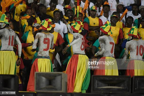 Senegalese supporters celebrate after a goal during the African Cup of Nations qualification match between Senegal and Niger on March 26 in Dakar...