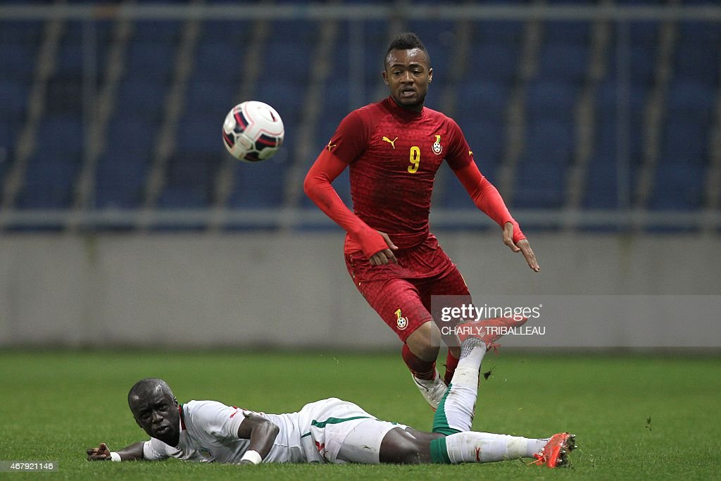 Senegal's Cheikh Mbengue (L) vies for the ball with Ghana's <a gi-track='captionPersonalityLinkClicked' href=/galleries/search?phrase=Jordan+Ayew&family=editorial&specificpeople=6595555 ng-click='$event.stopPropagation()'>Jordan Ayew</a> (R) during the International Friendly football match between Senegal and Ghana on March 28, 2015 at the Oceane stadium, in Le Havre, northwestern France.