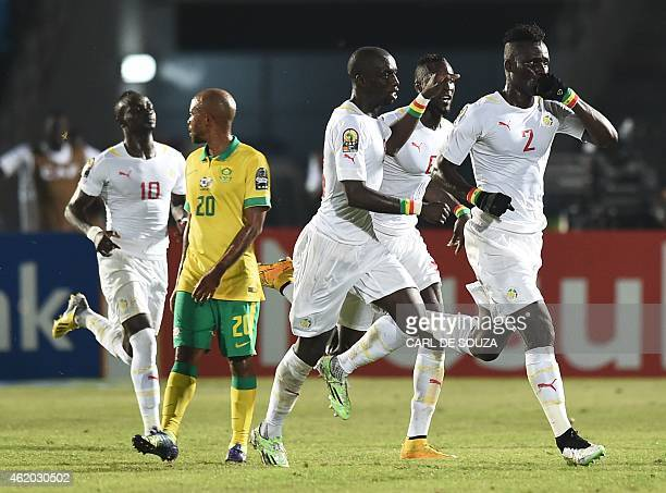 Senegal's defender Kara Mbodji celebrates after scoring a goal during the 2015 African Cup of Nations group C football match between South Africa and...