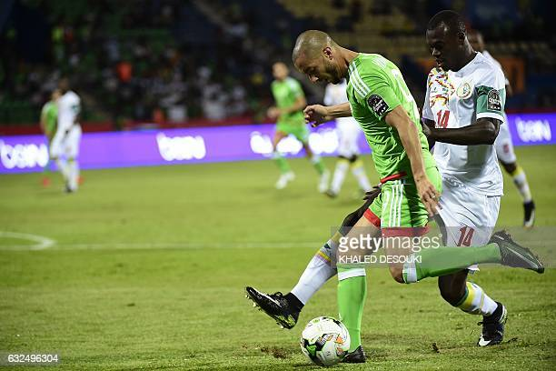 Senegal's defender Zargo Toure challenges Algeria's forward Sofiane Hanni during the 2017 Africa Cup of Nations group B football match between...