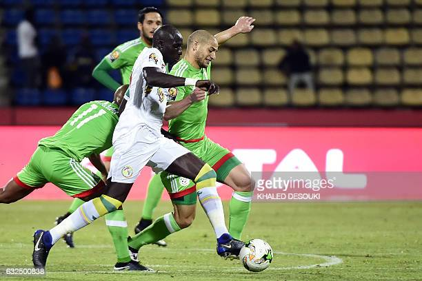 Senegal's forward Pape Moussa Konate challenges Algeria's midfielder Adlene Guedioura during the 2017 Africa Cup of Nations group B football match...