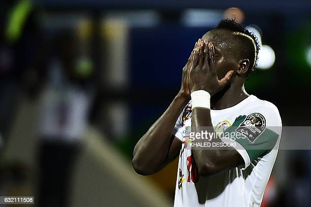 Senegal's forward Sadio Mane reacts after missing a goal opportunity during the 2017 Africa Cup of Nations group B football match between Senegal and...
