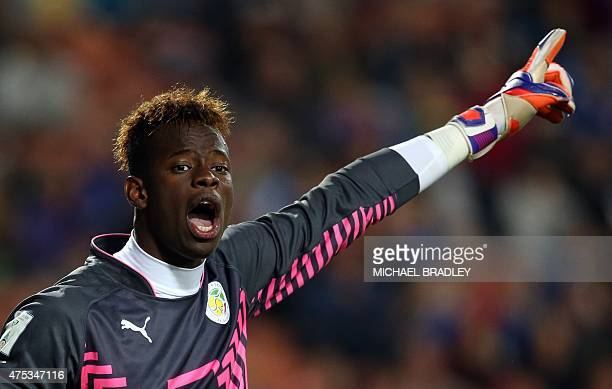 Senegal's goalkeeper Ibrahima Sy shouts to his teammates during the FIFA Under20 World Cup football match between Senegal and Portugal in Hamilton on...