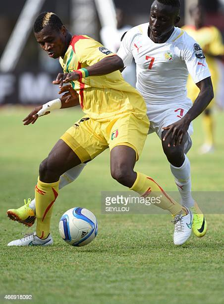 Senegal's Ibrahima Wadji challenges Mali's Youssouf Kone during the 2015 African U20 Championships semifinal football match between Senegal and Mali...