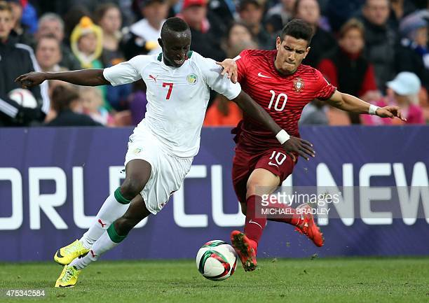 Senegal's Ibrahima Wadji fights for the ball with Portugal's Rony Lopes during the FIFA Under20 World Cup football match between Senegal and Portugal...