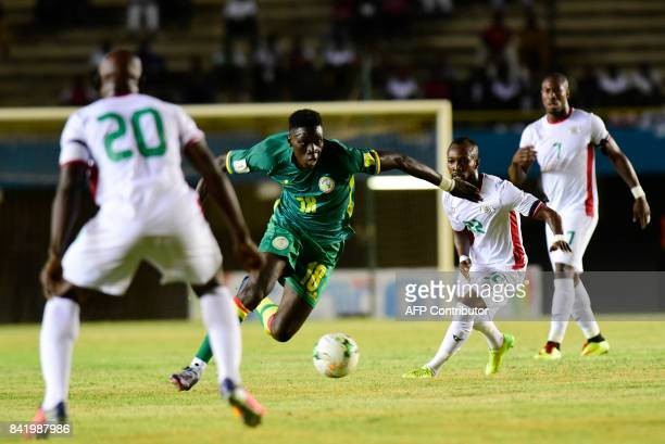 Senegal's Ismaila Sarr vies for the ball with Burkina Faso's Ibrahima Toure Blati during the World Cup 2018 Africa qualifying football match between...