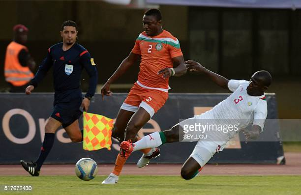 Senegal's Kalidou Koulibaly vies with Niger's Onouo Moussa Maazou during the African Cup of Nations qualification match between Senegal and Niger on...