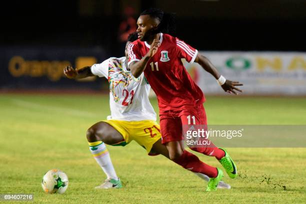 Senegal's Lamine Gassama vies for the ball with Equatorial Guinea's Disdado Mbele Mba during the 2019 Africa Cup of Nations qualifying football match...