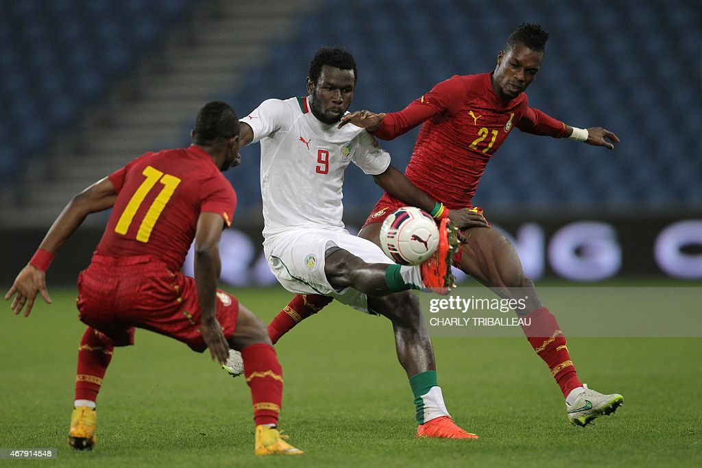 Senegal's Mame Birame Diouf (C) vies for the ball with Ghana's <a gi-track='captionPersonalityLinkClicked' href=/galleries/search?phrase=Wakaso+Mubarak&family=editorial&specificpeople=7523524 ng-click='$event.stopPropagation()'>Wakaso Mubarak</a> (L) and Ghana's <a gi-track='captionPersonalityLinkClicked' href=/galleries/search?phrase=John+Boye&family=editorial&specificpeople=7190220 ng-click='$event.stopPropagation()'>John Boye</a> during the International Friendly football match between Senegal and Ghana on March 28, 2015 at the Oceane stadium, in Le Havre, northwestern France. AFP PHOTO / CHARLY TRIBALLEAU