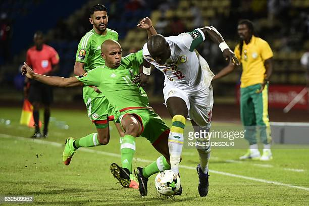 TOPSHOT Senegal's midfielder Mohamed Diame challenges Algeria's midfielder Yacine Brahimi during the 2017 Africa Cup of Nations group B football...