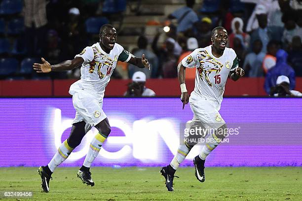 TOPSHOT Senegal's midfielder Papakouli Diop celebrates with Senegal's defender Zargo Toure after scoring a goal during the 2017 Africa Cup of Nations...