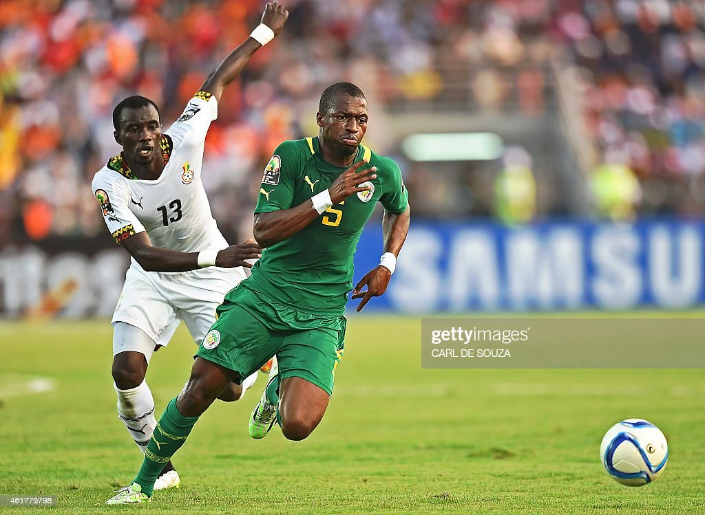 Senegal's midfielder Papakouli Diop (R) challenges Ghana's midfielder <a gi-track='captionPersonalityLinkClicked' href=/galleries/search?phrase=Mohammed+Rabiu&family=editorial&specificpeople=6335728 ng-click='$event.stopPropagation()'>Mohammed Rabiu</a> during the 2015 African Cup of Nations group C football match between Ghana and Senegal in Mongomo on January 19, 2015.