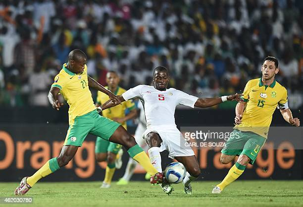 Senegal's midfielder Papakouli Diop vies with South Africa's defender Ayanda Gcaba and South Africa's midfielder Dean Furman during the 2015 African...