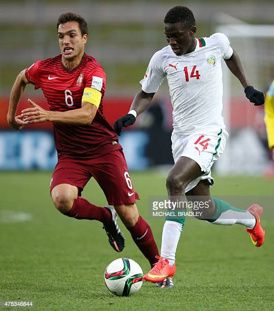 Senegal's Moussa Kone fights for the ball with Portugal's Tomas during the FIFA Under20 World Cup football match between Senegal and Portugal in...