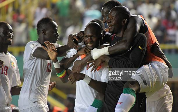 Senegal's Moussa Sow celebrates with teammates after scoring during the World Cup 2018 qualifier match Senegal versus Cape Verde on October 8 2016 at...