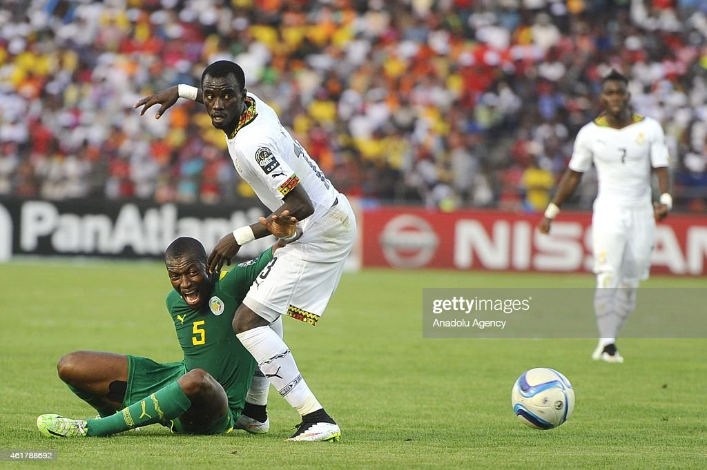 Senegal's Papakouli Diop (L) in action against Ghana's <a gi-track='captionPersonalityLinkClicked' href=/galleries/search?phrase=Mohammed+Rabiu&family=editorial&specificpeople=6335728 ng-click='$event.stopPropagation()'>Mohammed Rabiu</a> (R) during the 2015 African Cup of Nations Group C soccer match between Senegal and Ghana at Mongomo Stadium in Mongomo on January 19, 2015.