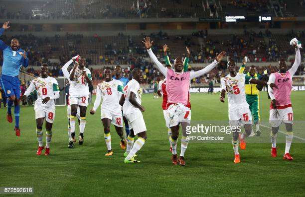 Senegal's players celebrate after winning the FIFA 2018 World Cup Africa Group D qualifying football match between South Africa and Senegal at The...