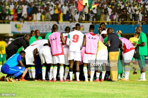 Senegal's players celebrate after winning the FIFA 2018 World Cup Africa Group D qualifying football match between South Africa and Senegal at...