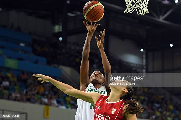 TOPSHOT Senegal's power forward Astou Traore and Serbia's forward Sonja Petrovic go for a rebound during a Women's round Group B basketball match...