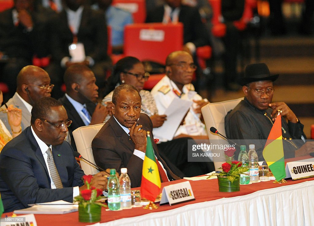 Senegals' President Macky Sall (L), Guinea's president Alpha Conde and Nigeria's President Goodluck Jonathan sit during the opening session of the regional bloc ECOWAS summit on expediting an African force to come to Mali's aid, on January 19, 2013 in Abidjan. Ivorian President and current head of the regional bloc ECOWAS, Alassane Ouattara today called for a broader international commitment to the military operations in Mali, where Malian and French forces are battling Islamist militant groups that control the country's vast arid north.