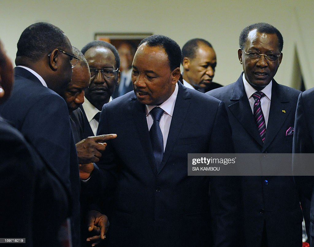Senegal's President Macky Sall, Guinea's President Alpha Conde, Niger's President Mahamadou Issoufou, Tchad President Idriss Deby talk during the regional bloc ECOWAS summit on expediting an African force to come to Mali's aid, on January 19, 2013 in Abidjan. Ivorian President and current head of the regional bloc ECOWAS, Alassane Ouattara today called for a broader international commitment to the military operations in Mali, where Malian and French forces are battling Islamist militant groups that control the country's vast arid north.