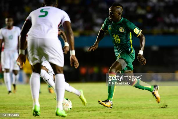 Senegal's Sadio Mane vies for the ball with during the World Cup 2018 Africa qualifying football match between Senegal and Burkina Faso at the...