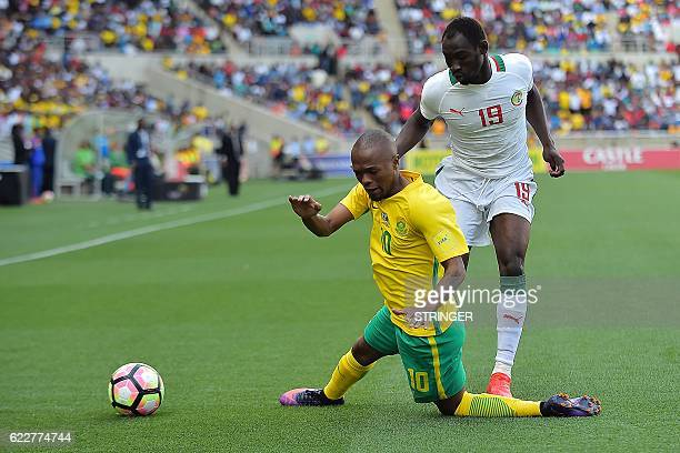 Senegal's Saliou Ciss tackles South Africa's Thulani Serero during the 2018 World Cup qualifying football match between South Africa and Senegal on...
