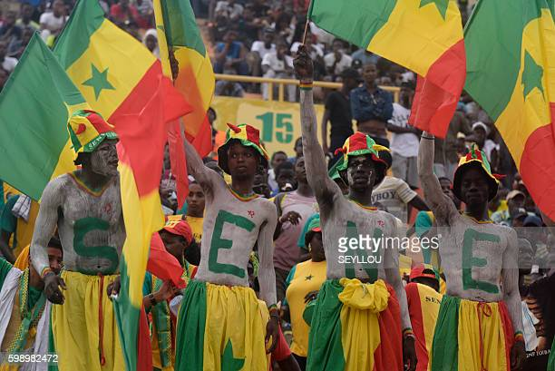 Senegal's supporters cheer their team during the 2017 African Cup of Nations qualification football match between Senegal and Namibia on September 3...