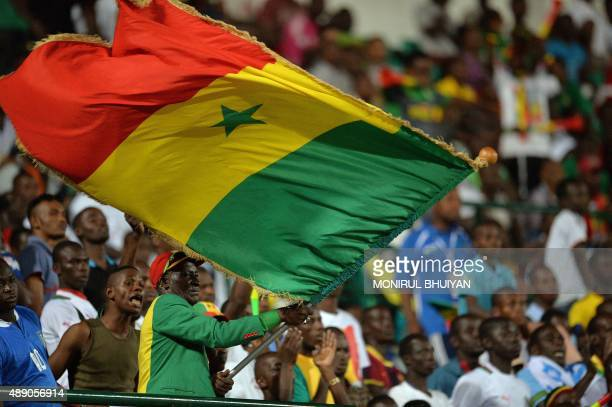Senegal's supporters cheer their team during the men final football match in the 11th Africa Games between Senegal and Burkina Faso on September 18...