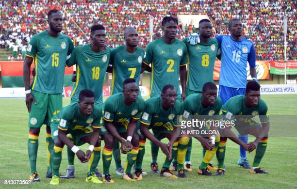 Senegal's team players pose on September 5 2017 at the stade du 26 aout in Ouagadougou during the World Cup 2018 Africa qualifying football match...
