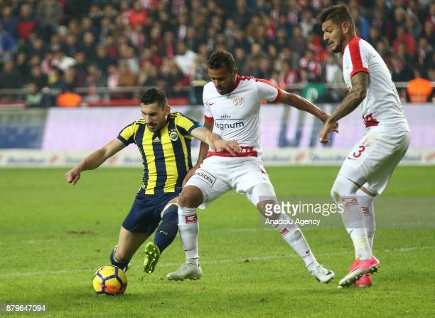 Sener Ozbayrakli of Fenerbahce in action against Charles of Antalyaspor during the Turkish Super Lig match between Antalyaspor and Fenerbahce at...