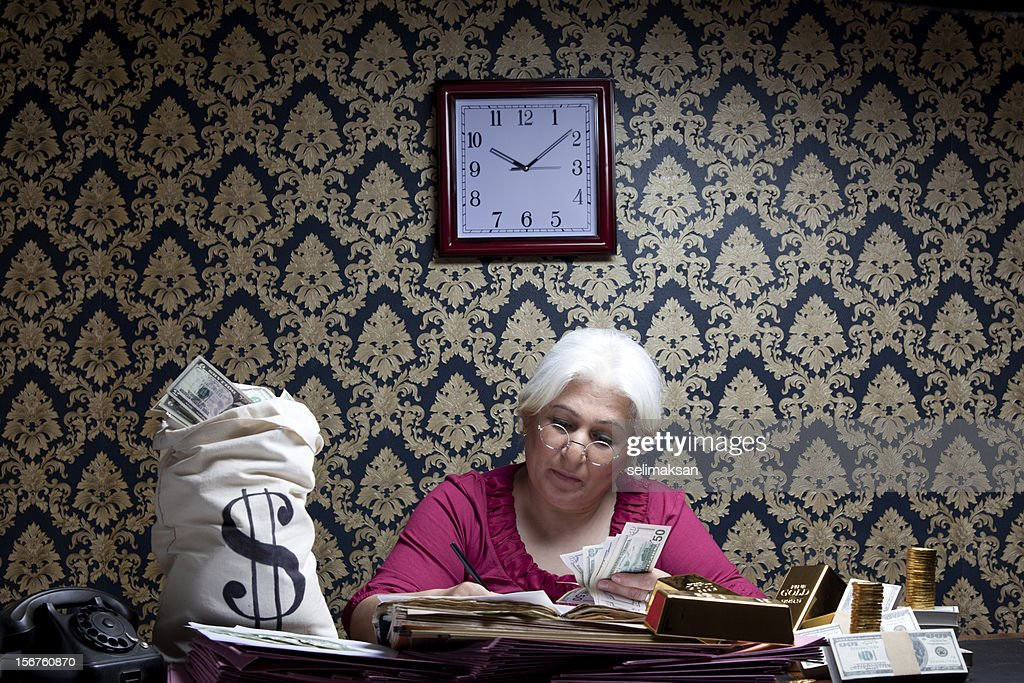 Accountant woman counting money : Stock Photo