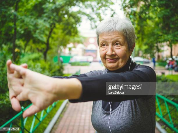 Senior active sporty woman in park