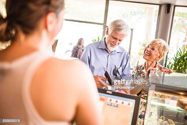 senior adult at the bar counter