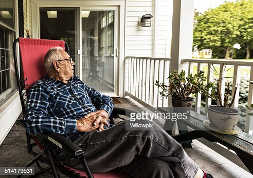 Senior Adult Elderly Man Relaxing On Front Porch