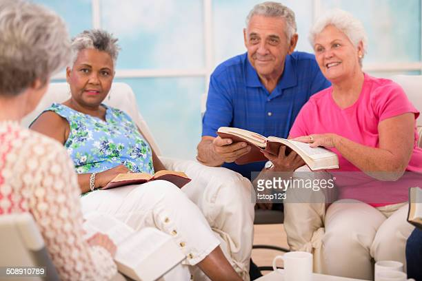 Senior adult friends, couple during bible study group.