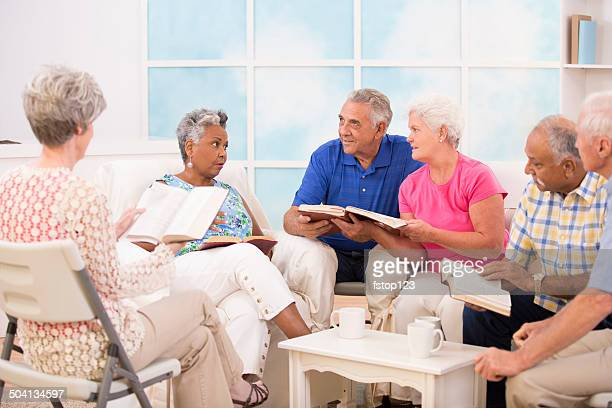 Senior adult friends, couples during bible study group.
