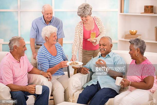 Senior adult friends share news, friendship.  Home or assisted living.