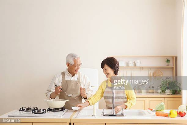 Senior adult Japanese couple in the kitchen
